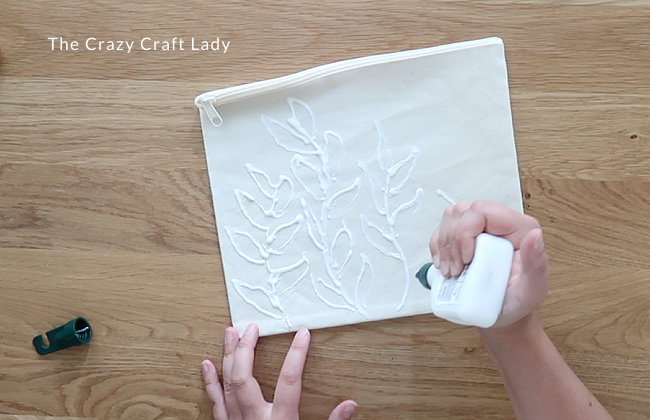 Use the tip of the glue bottle to apply any design to your fabric.