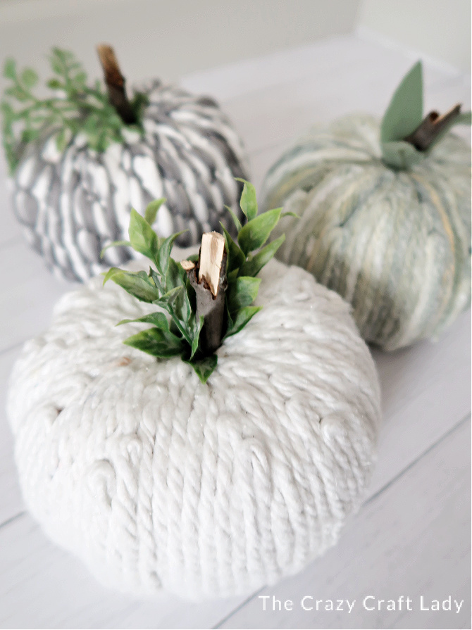 Yarn pumpkins from dollar store mop heads