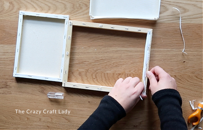 cut the canvas away from the wood frame