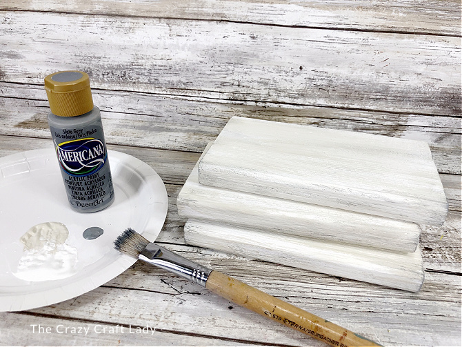 paint the scrap wood a combination of white and ivory