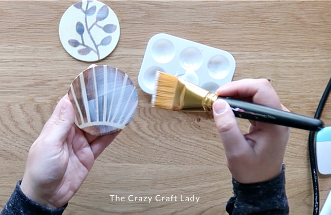 Apply Mod Podge to the wood surface to seal