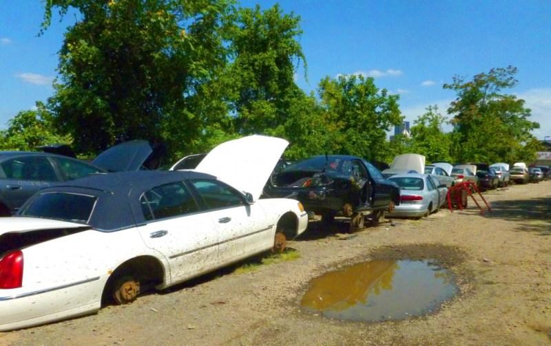 The auto recycling lot.