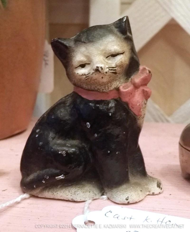 Little cast iron tuxie kitty.