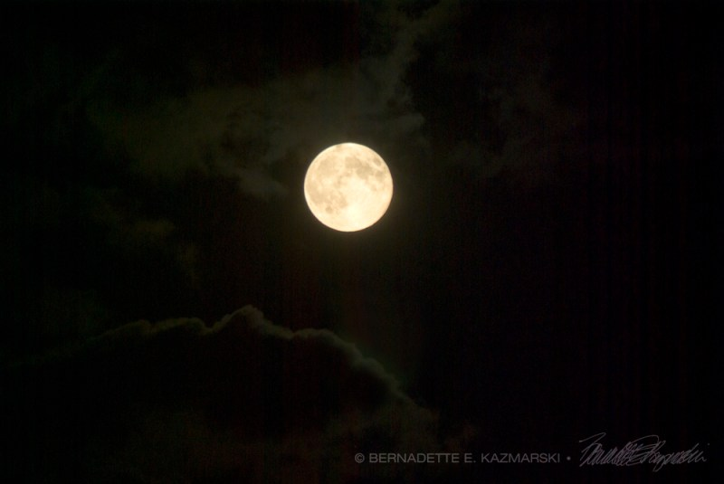 supermoon in clouds
