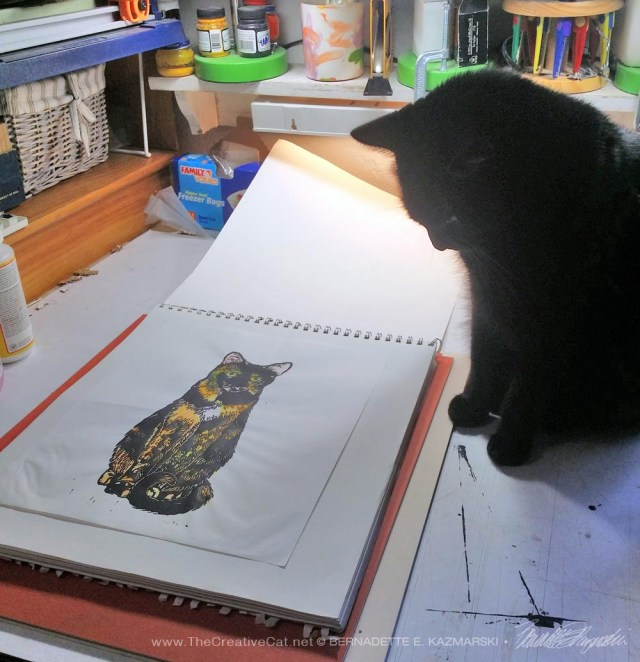 black cat with block print