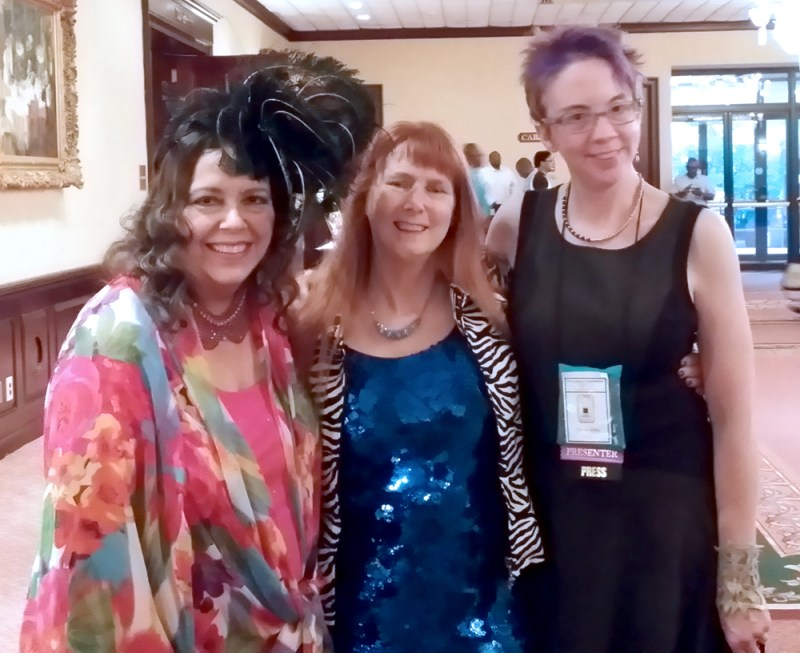 Carole Nelson Douglas, Dusty RAinbolt and JaneA Kelly at the Cat Writers' Conference.