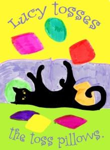 black cat tossing pillows