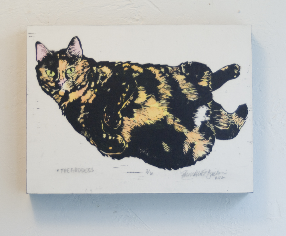 hand-colored linoleum block print of cat