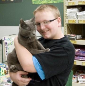 boy holding gray cat