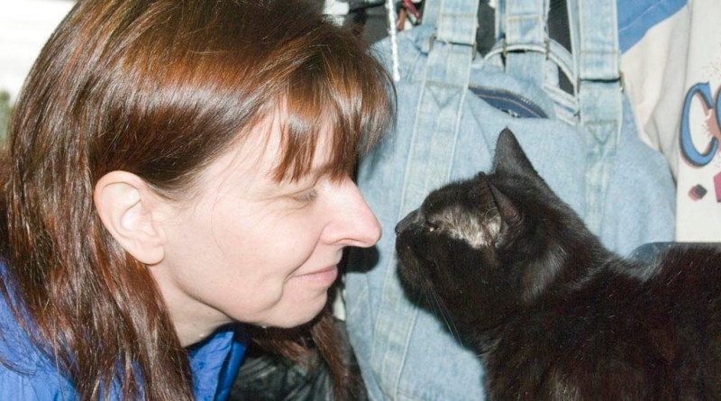 black cat with person