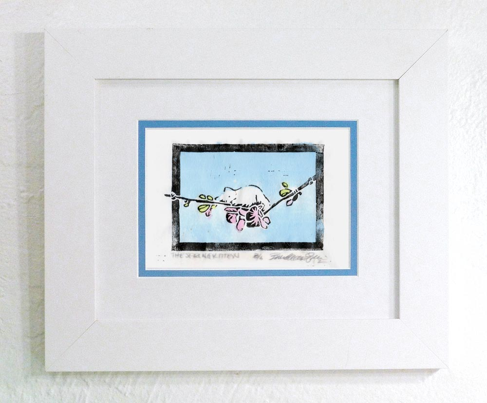 """The Spring Kitten"" linoleum block print on rice paper, black ink and hand-colored with watercolors, white frame with blue and white mats"