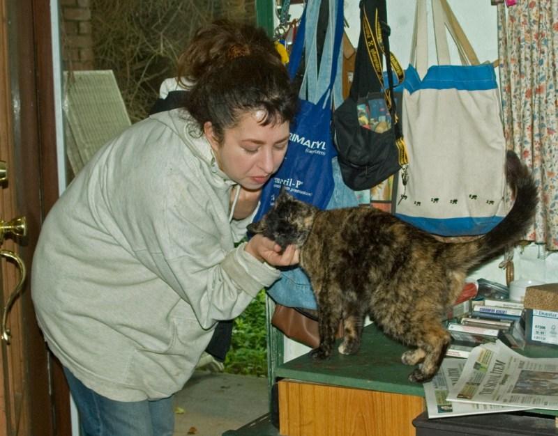 tortoiseshell cat with woman