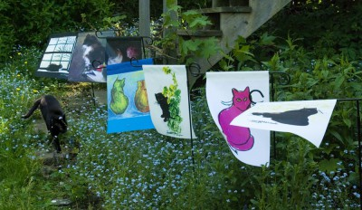 black cat with garden flags.
