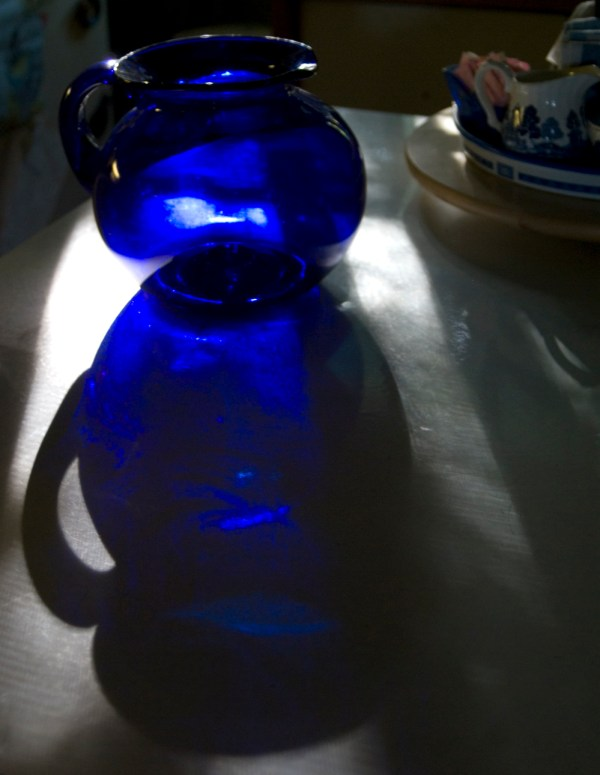 blue pitcher on table