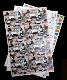 """Text weight art papers, 11"""" x 17""""., with cat artwork."""