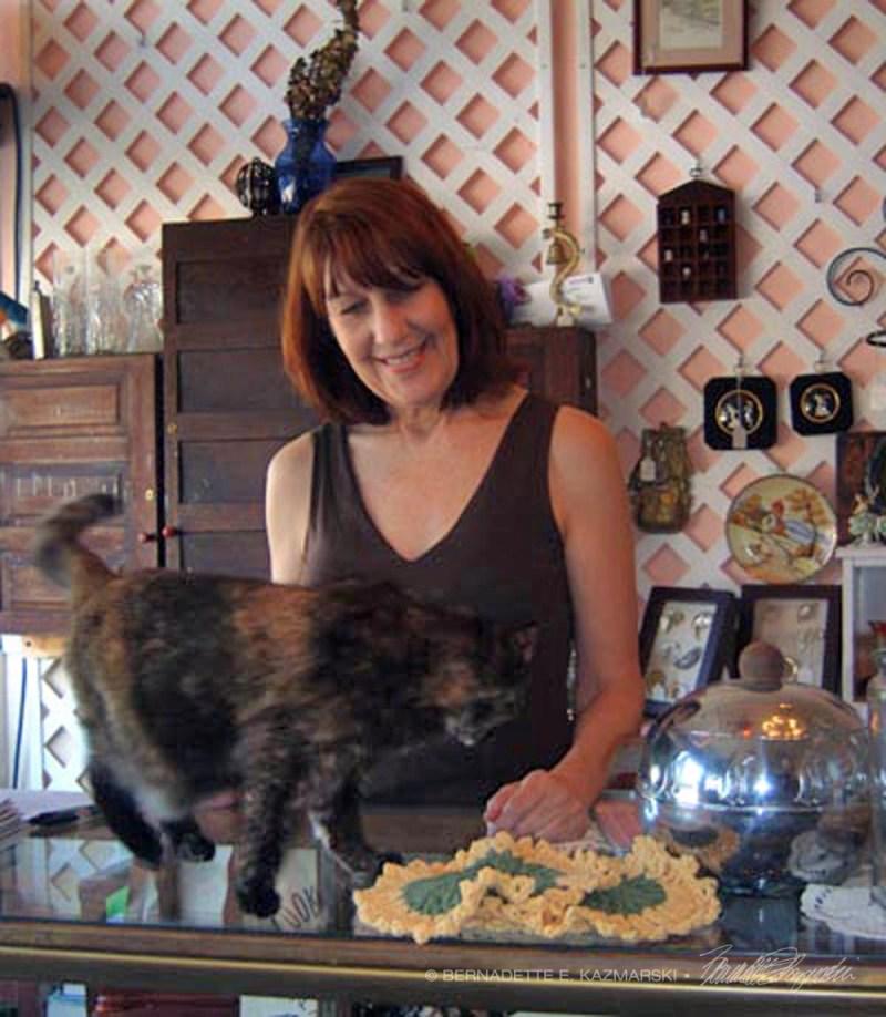 tortoiseshell cat and woman