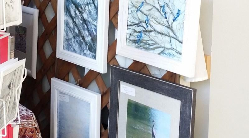 Framed prints of sketches.