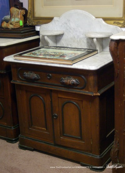 The marble-topped dressing table.