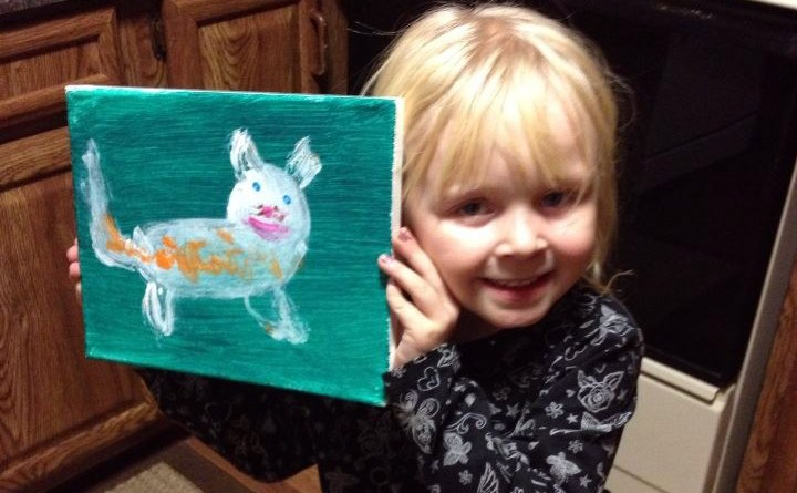 little girl with cat painting.