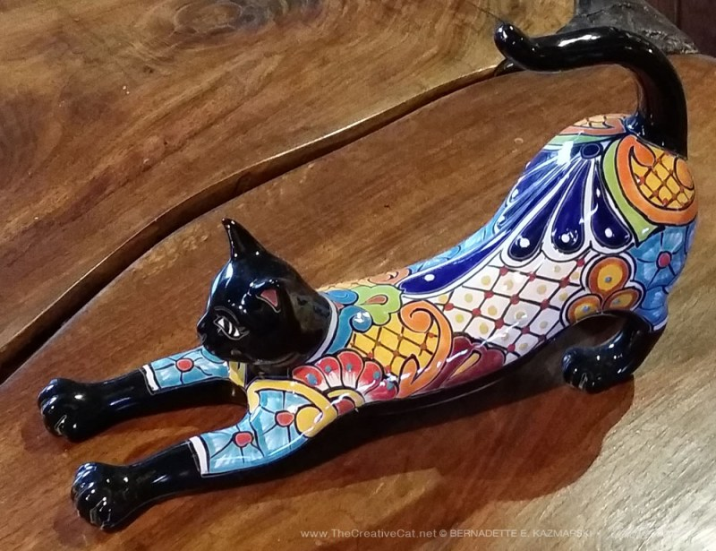 From the side. painted black cat figurine