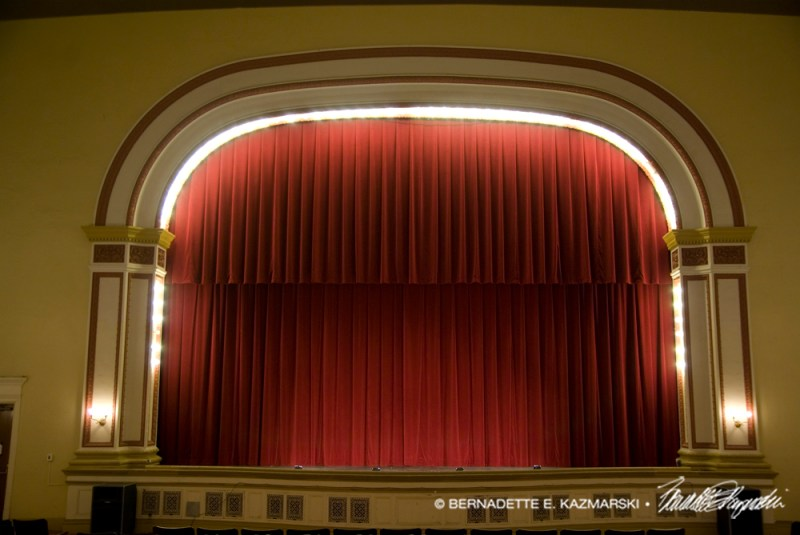 The proscenium and curtain of the stage at Andrew Carnegie Free Library Music Hall