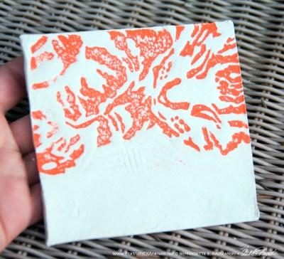 """Air-dry clay tile, """"Wrinkled Pajamas"""" in orange."""