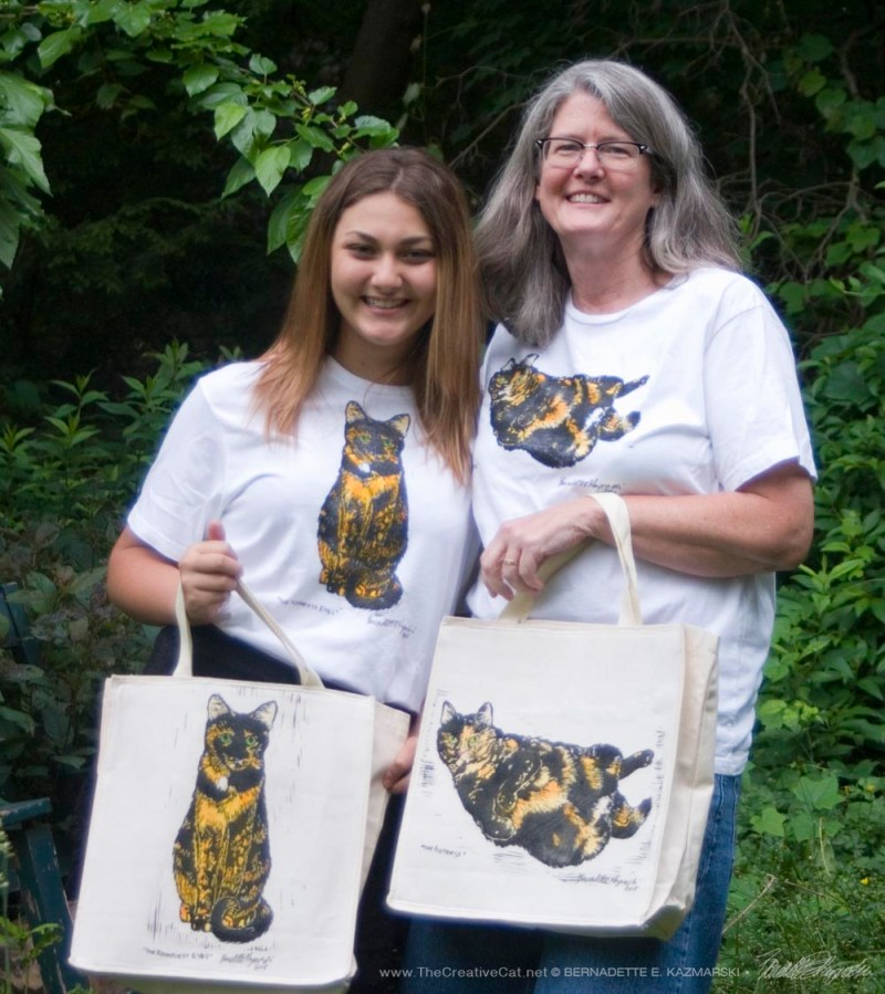 Jenna and her mom Mary Kay model the new tees and totes.