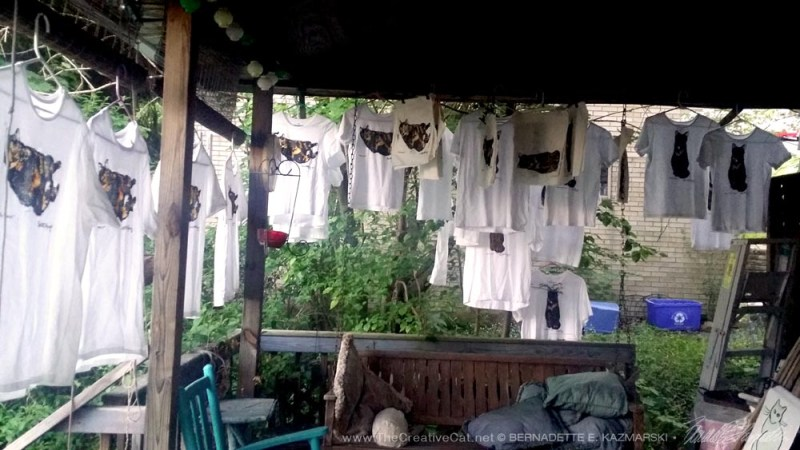 The hand-tinted tees drying all around my deck.