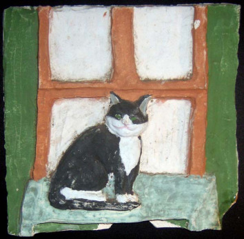 Bootsie on a ceramic tile from tenth-grade ceramics.