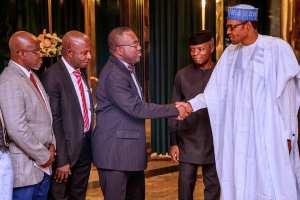 President Buhari appreciates the panel members after the presentation.