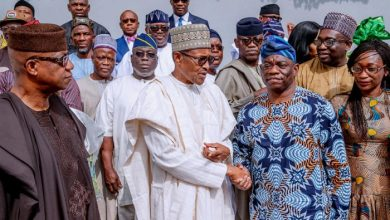 President in hand shake with the scion of Abiola Family, Kola Abiola