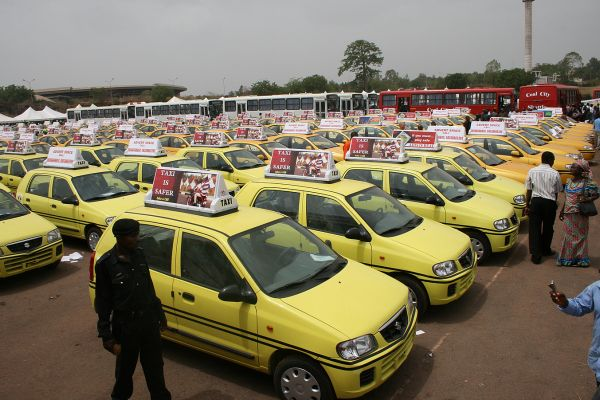A typical taxi park in Nigeria