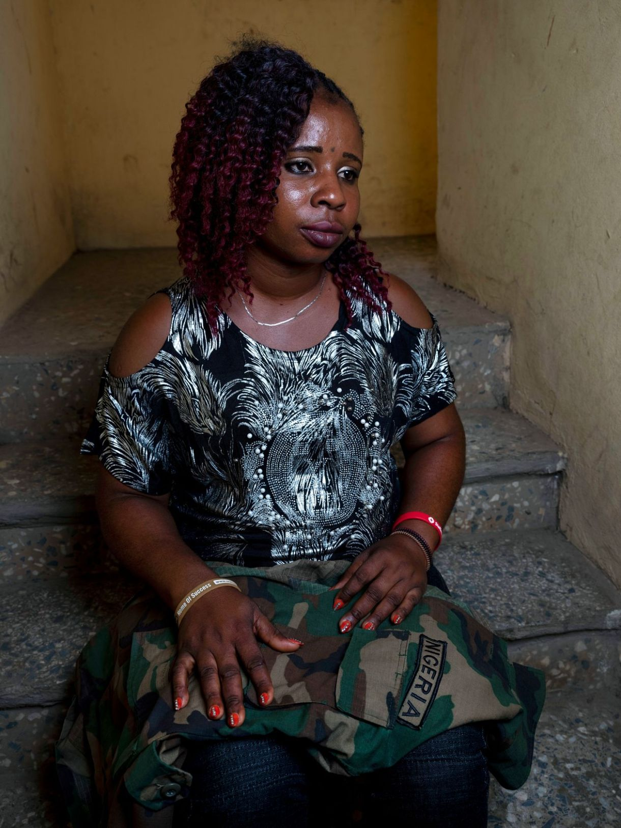 Mercy Tamuno in Abuja, Nigeria, with her husband's uniform. Officials told her he was killed in an insurgent attack on an outpost in the country's northeast