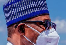 First time out...Buhari in face mask