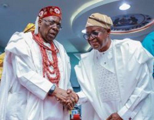 Owa Obokun Adimula of Ijesaland, Oba Dr. Adekunle AromolaranI in a warm handshake with Gov. Oyetola (file photo)