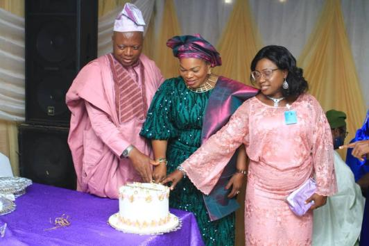 (L-R)Prof.Olayinka,Chief Mrs. Awomolo and Dr. Eyiwumi Olayinka cutting the anniversary cake