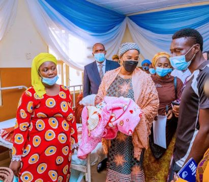 Representative of Mrs. Aisha Buhari, Dr Mairo Almakura, welcomes first baby of the year