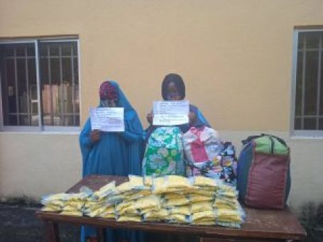 Chioma and Chidinma in hijab with their exhibits