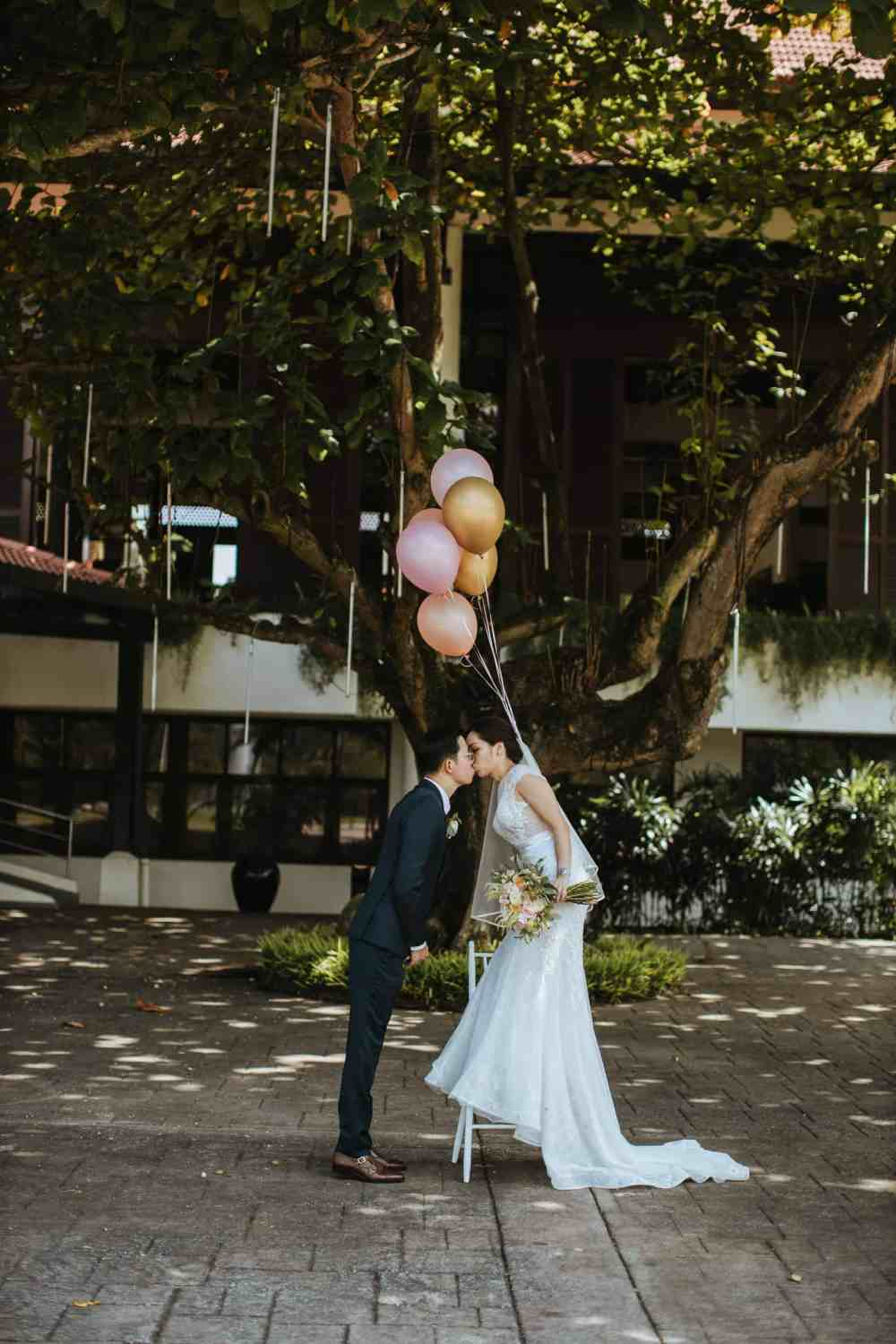 Garden Romantic Rustic Rosy Golden Wedding at The Saujana Hotel Subang Kuala Lumpur malaysia cliff choong the cross effects kevin tan destination portrait and wedding photographer malaysia kuala lumpur bride and groom couple kiss romantic intimate moment scene exchanging Rings
