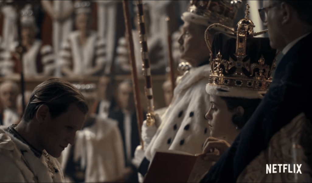 Prince Philip kneels before The Queen at the coronation - but the scene is fraught with tension. (Netflix)