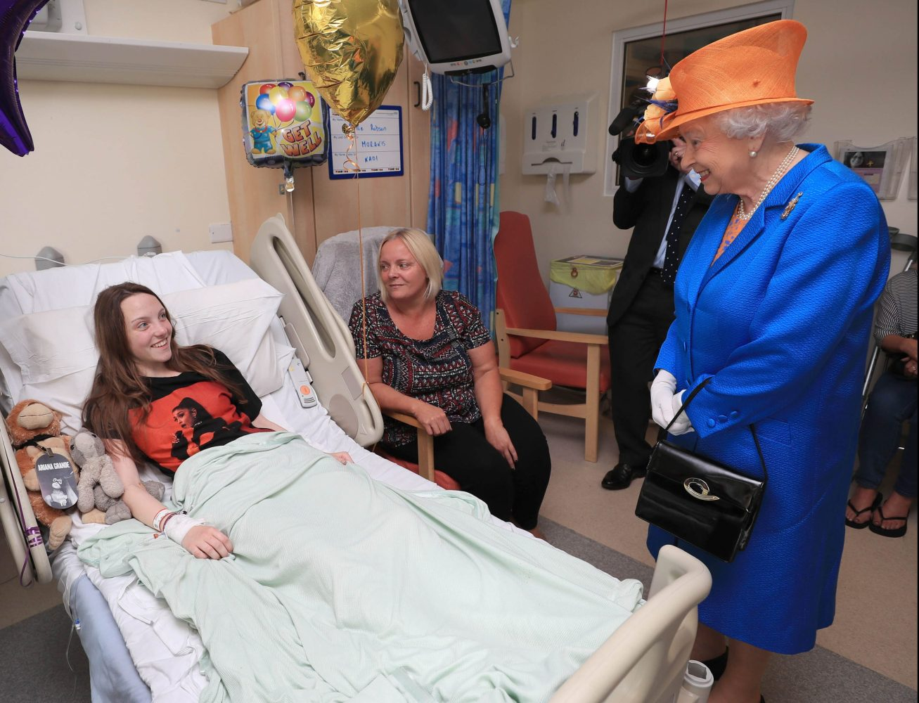 The Queen speaks to Millie Robson, 15, during a visit to the Royal Manchester Children's Hospital to meet victims of the terror attack earlier this week. Picture by  i-Images / Pool