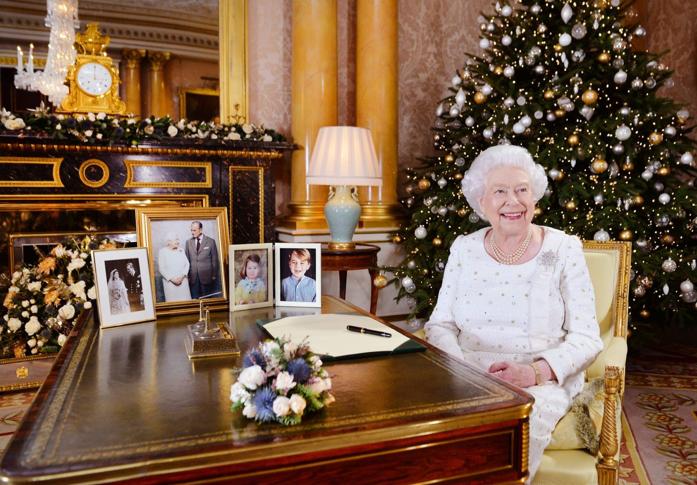 Image licensed to i-Images Picture Agency. 25/12/2017. London, United Kingdom. Queen Elizabeth II sits at a desk in the 1844 Room at Buckingham Palace, London, after recording her Christmas Day broadcast to the Commonwealth.  Picture by ROTA / i-Images