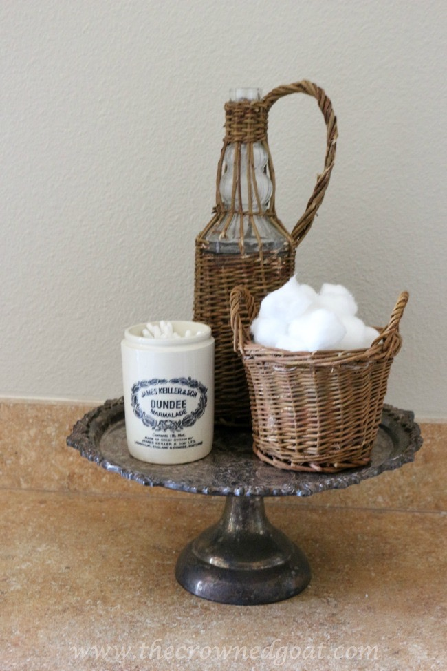 Using-a-Silver-Cake-Stand-to-Keep-Bathroom-Accessories-Organized-061815-15 Master Bathroom Makeover Decorating