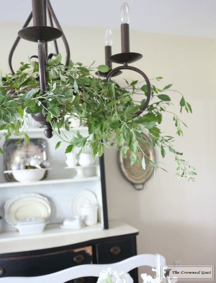 Simple-Holiday-Chandelier-with-Greenery-6 Adding Holiday Greenery to Simple Chandeliers Christmas DIY Holidays