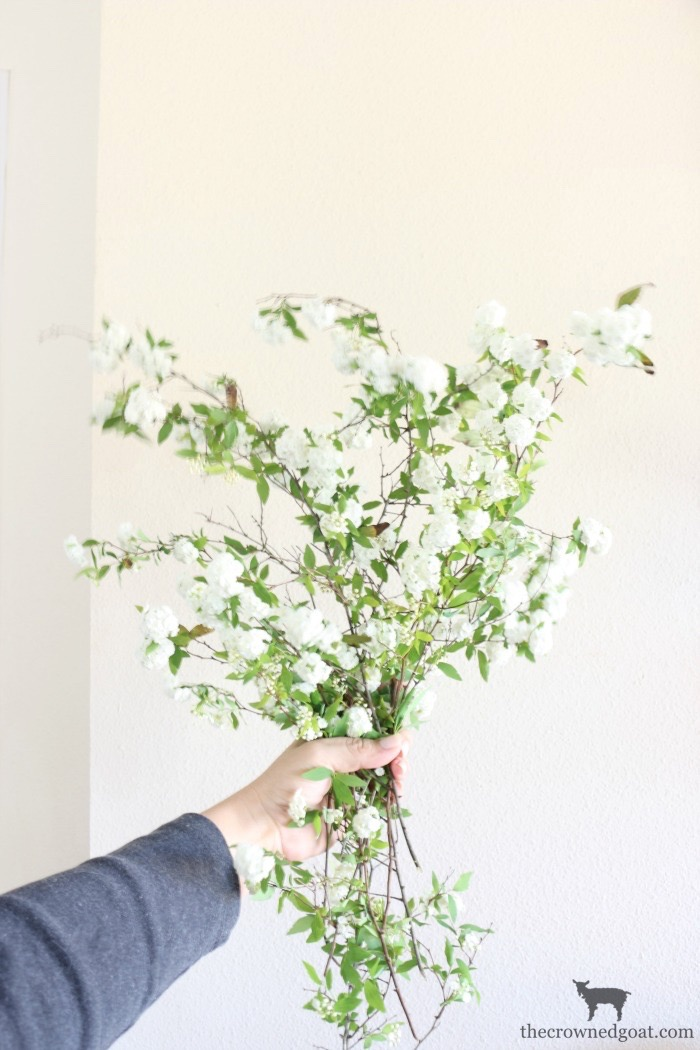 Adding-Spring-Greenery-to-Dining-Room-Chandelier-The-Crowned-Goat-1 How to Decorate a Chandelier with Flowers for Spring Decorating DIY Spring
