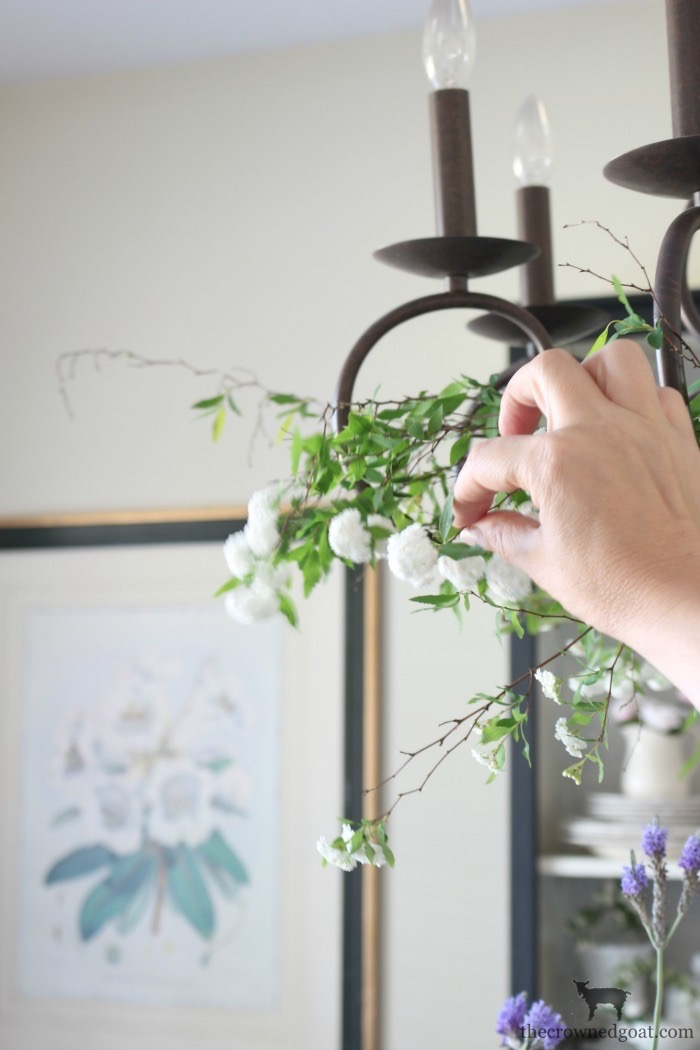 Adding-Spring-Greenery-to-Dining-Room-Chandelier-The-Crowned-Goat-3 How to Decorate a Chandelier with Flowers for Spring Decorating DIY Spring