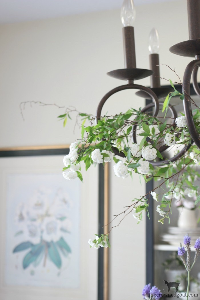 Adding-Spring-Greenery-to-Dining-Room-Chandelier-The-Crowned-Goat-4 How to Decorate a Chandelier with Flowers for Spring Decorating DIY Spring
