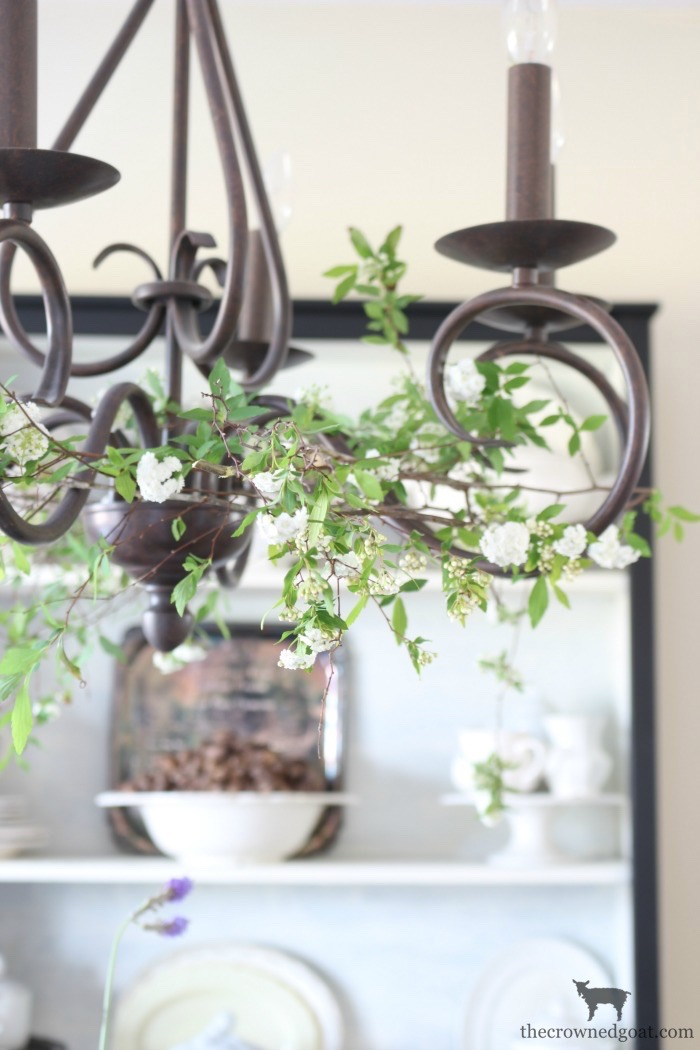 Adding-Spring-Greenery-to-Dining-Room-Chandelier-The-Crowned-Goat-6 How to Decorate a Chandelier with Flowers for Spring Decorating DIY Spring