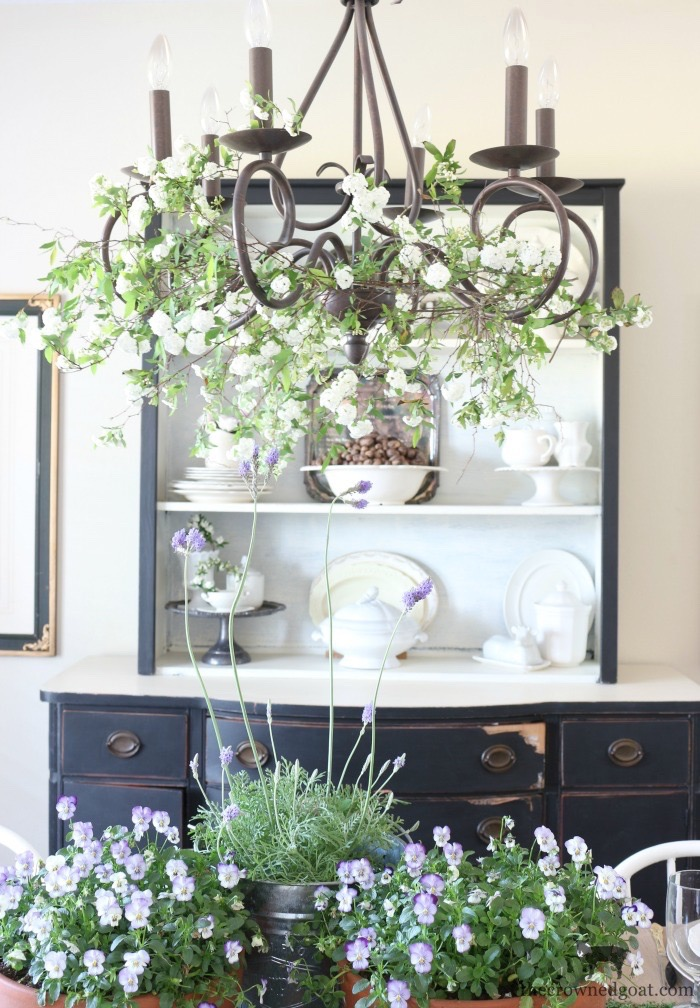Adding-Spring-Greenery-to-Dining-Room-Chandelier-The-Crowned-Goat-8 How to Decorate a Chandelier with Flowers for Spring Decorating DIY Spring