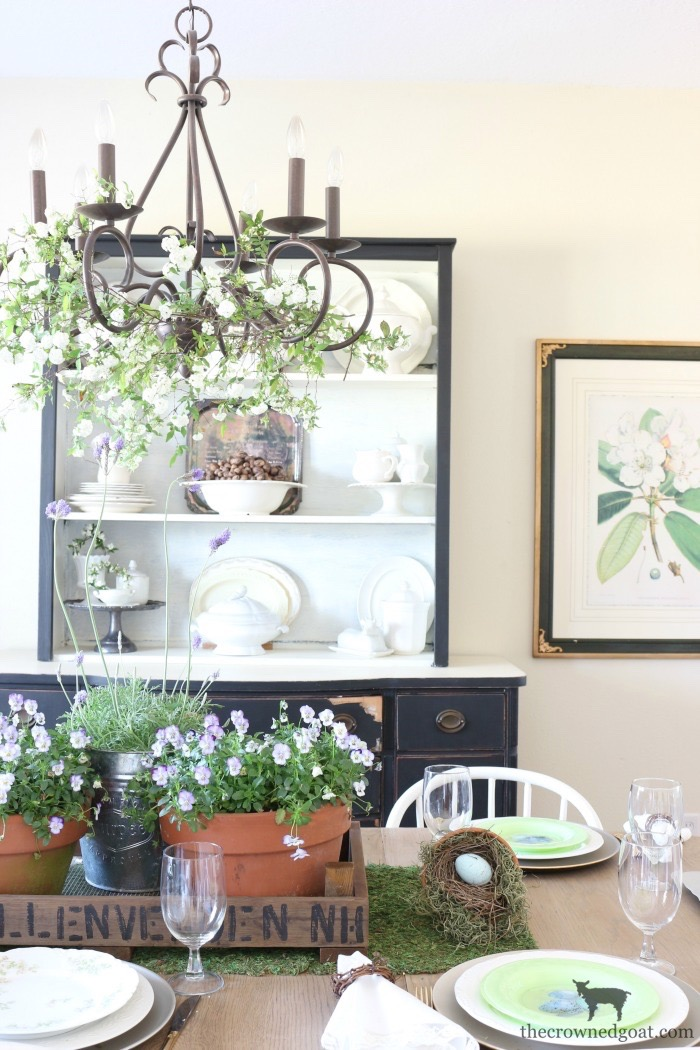 Adding-Spring-Greenery-to-Dining-Room-Chandelier-The-Crowned-Goat-9 How to Decorate a Chandelier with Flowers for Spring Decorating DIY Spring